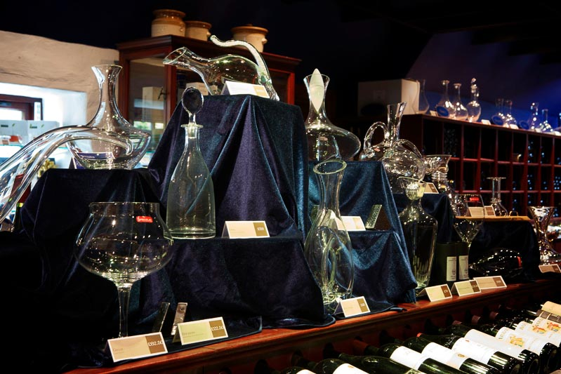 Display of decanters, wine glasses and accessories in Champany Cellars.